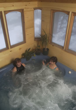 Enjoy the bubbling hot tub after a day of activities at Ski Town Condos!