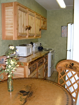 Beautiful rustic log cabinets.  Fully equipped kitchen including microwave at Ski Town Condos Vacation Rentals.