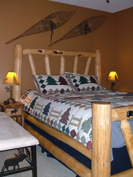Beautiful queen size log bed with a down comforter.  Ski Town Condos