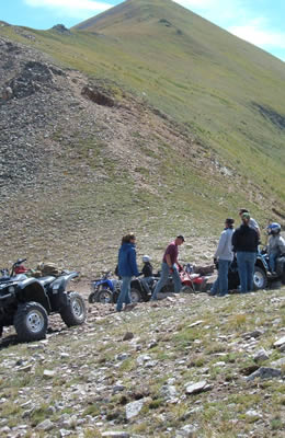 Large ATV group riding high above timberline.